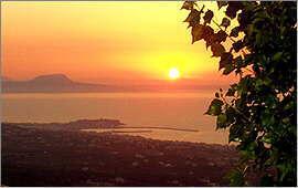 Sonnenuntergang: Hafen von Rethymnon und Kap Drapanon